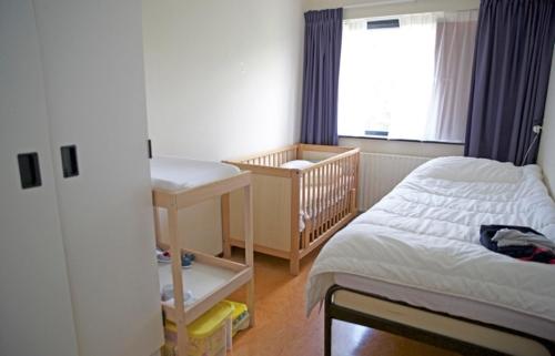 De slaapkamer voor ouder en kind.